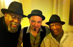 BILL SIMS JR., MATTHEW AND TAJ MAHAL AT THE AULNAY ALL BLUES FESTIVAL IN AULNAY-SOUS-BOIS, FRANCE SHARING A POST GIG COGNAC. (NOVEMBER 2011)