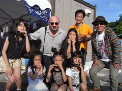 MATTHEW HOLDS A  HARMONICA WORKSHOPFOR JAPANESE CHILDREN IN AOMORI JAPAN IN 2012.